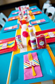 Festive table with pom pom decor. hwtm.com
