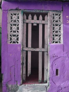 No matter what condition your door is in, if you have a purple home it still looks lovely! green doors, puerto rico, la perla, window, colors, purpl, colorful doors, old doors, gate