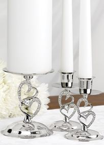 "Make your unity candle ceremony dazzling by displaying your candles in these beautiful stands. The nickel-plated stands have rhinestone-studded hearts in a romantic embrace on the stems.   4 1/2"" tall center stand holds a unity candle up to 3"" in diameter.  4"" tall taper stands hold standard taper candles.  Candles not included."
