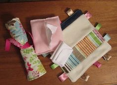 little dolly diapers, diaper wipes,roll-up changing pads, andminiature taggies