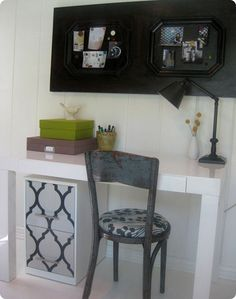 simple white desk and wallpapered file cabinet!