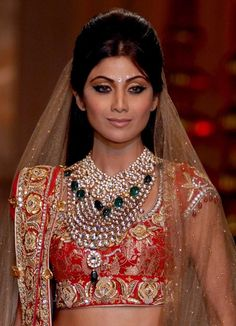 Shilpa Shetty in Bridal Jewellery at India Couture Week beautiful cabachon diamond and emerald stone necklace