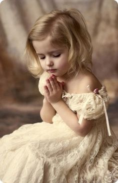 Precious little girl praying.
