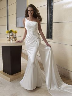 This one shoulder dress has a low back with crisscross straps wedding dressses, lace wedding dresses, rehearsal dress, dress wedding, simple weddings, one shoulder, beach weddings, gown, beach wedding dresses