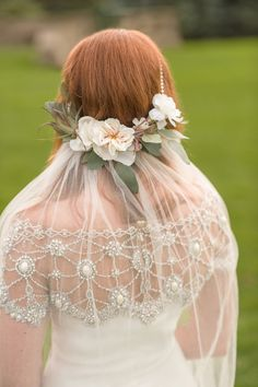 Her Grandmother's pearls to anchor her veil - so lovely! Wedding Gown by Marchesa