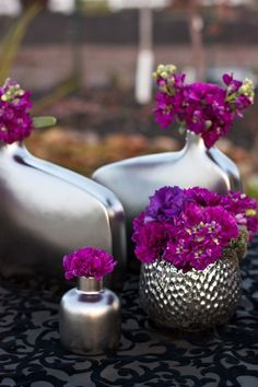 The metallic silver vases are nothing compared to the purple, red hue of radiant orchid. These flowers are incredible and look great with a neutral background.