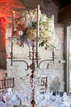 Wedding Centerpiece - Candelabra with Crystals | See the wedding on SMP: http://www.StyleMePretty.com/midwest-weddings/2014/03/07/irish-barn-glam-wedding-at-whistling-straits/ Photography: Heather Cook Elliott