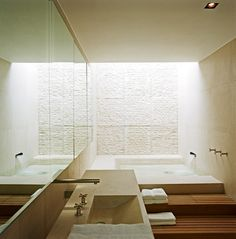 Bathroom with skylight. Residential project in London by Powell Tuck Associates.