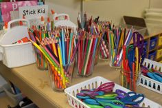 These colored pencils in clear flared plastic cups are so pretty and inviting in Mandy Robek's kindergarten classroom.