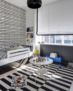 Design Reveal: Gabriel's Big Boy Room! We love the graphic black and white patterns and subtle pops of royal blue and yellow!