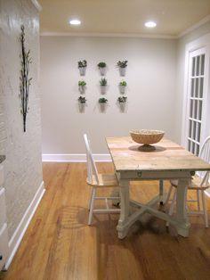 Create a creative indoor vertical garden using just a few tin buckets and pretty succulents. || @tenjuneblog