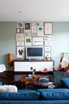 lovely gallery wall incorporates the TV || At Home With Sarah Sherman Samuel