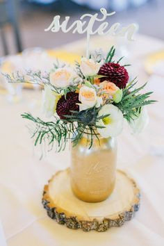 table number centerpieces, photo by Michael Rousseau Photography http://ruffledblog.com/craigleith-ski-club-wedding #weddingideas #tablenumbers