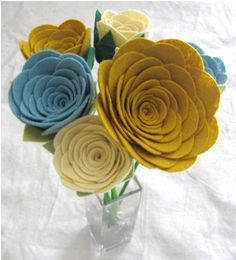 I need to learn how to make these: mustard, safflower and cream felt flowers.