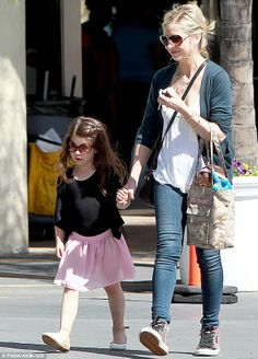 Protective: Sarah held her daughter's happily hand throughout their walk
