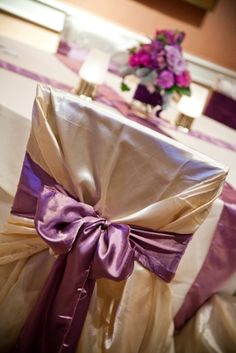champagne chair cover with purple sash