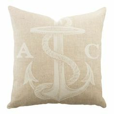 Bring a personalized pop to your sofa or bed with this costal-inspired pillow. Handmade in the USA, this charming design is crafted from cotton denim and showcases an anchor motif.   Product: PillowConstruction Material: Cotton denim coverColor: Beige and whiteFeatures:   Two letter personalization Insert includedZipper enclosureMade in the USA Cleaning and Care: Dry clean