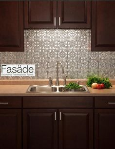 """""""FASADE"""" backsplash - quick and easy to install -- great for a quick new look & for renters who don't want to damage walls And they have it at home depot."""