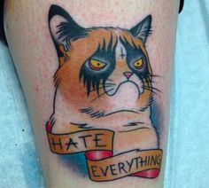 A Grumpy Cat tattoo. Not amused.