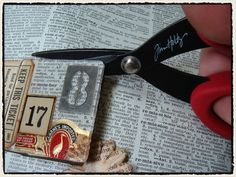 Tim Holtz -- kewl!  just pick a spot and create around it -- then clip it out! ha