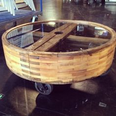 Amazing coffee table we made from old industrial wooden gear. 4 old wheels & a piece of glass cut for the top. Michael Strahan called dibs on it! #FleaMarketFabulous