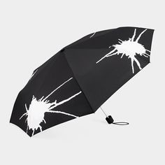 Umbrella changes color and makes a splatter pattern when the rain hits it