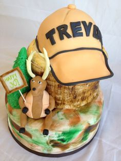Deer/camouflage cake.  I would just put the name on the stump & eliminate the hat.  I would also like to have the deer holding a shotgun.