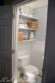 Shelves behind potty in kids' bathroom