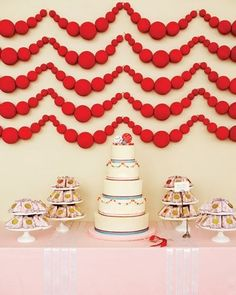 Easy backdrop- spray painted foam balls, strung together.