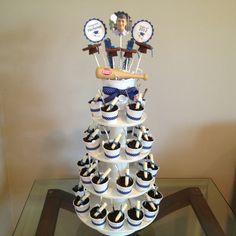 Graduation dessert tower.  I made and designed this as a fun way to display mini buckets of dirt cake, graduation cap pops, and wafer diplomas.   Designed to match the high school colors.