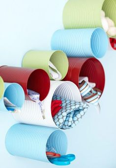 Mount painted cans on the wall in the bathroom or craft room to hold items that are used frequently.
