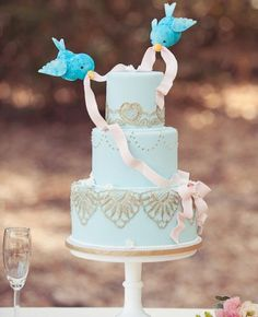 A Cinderella Blue Birds Wedding Cake // Subtle Disney Wedding Ideas // Featured: The Knot Blog