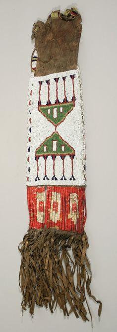 "Pipe bag, late 19th c., Oglala Lakota (Oglala Sioux peoples),Central Plains, South Dakota  Buckskin, glass beads, porcupine quills, pigment - 21.75"" x 7""  courtesy U of Virginia Art Museum"