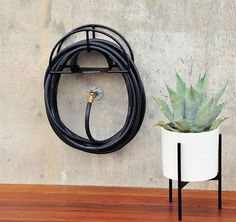 cool storage ideas for the garden hose// Apartment therapy     @Erin Walsh