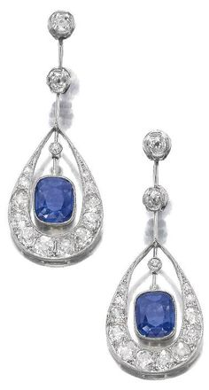 Pair of sapphire and diamond pendent earrings, circa 1910.     Each pear-shaped pendant millegrain set at the centre with a cushion-shaped sapphire, highlighted with cushion-shaped, circular- and single-cut diamonds, connected to the surmount by a knife edged linking. Sotheby's.