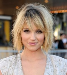 Dianna Agron sexy layered bob hairstyle   Celebrity messy bob haircut for women: Dianna Agron showed a new sexy side in a tousled layered bob with dark roots and razor-cut side-swept bangs.
