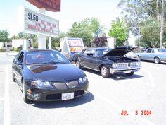 Black 1964 GTO with a Black 2004 GTO