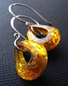 Gorgeous vintage glass teardrops with a gold foil backing allows these beauties to sparkle like crazy!  The amber/honey hue is simply dazzling.  Finished with my hand forged ear wires in sterling silver.