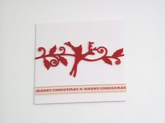 Red Christmas Reindeer - One of the Vintage Pearl papers inspired by exquisite fabric textures and retro colour. Featuring a 3-leaf embroidery embossing with white reverse. Reveals its charming texture when caught in the light. The design features red decorative felt border and as finishing touch a woven ribbon runs through the front of the card saying: 'merry christmas'. It comes with white envelope in protective cellobag.