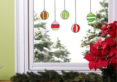 Christmas Ornament Window Clings. Decorate your windows as well as your house with these easy to make ornaments. #crafts #christmas