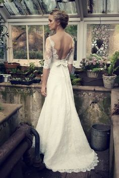 Elbeth Gillis 2014 Collection: Catherine Catherine  Showcasing a detachable dupion silk sash, the modern mermaid silhouette of Catherine is further accentuated by the softness of  a sweetheart neckline, low back design and charming three-quarter sleeves crafted from Chantilly lace overlay.