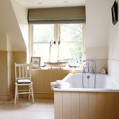 Dark cream and white tongue and groove bathroom