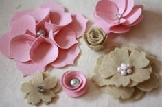Felt Flowers Tutorial.  There are so many designs that can easily be created using a few felt flower techniques.