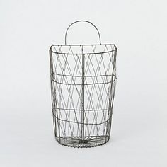 Wire Wall Basket.... large in size... only $20.  It would be cool to line up several in a laundry room for clean sock storage for each individual in your home, clean towel storage next to your shower, toilet paper holder in bathroom.... list can go on and on!  very cool.