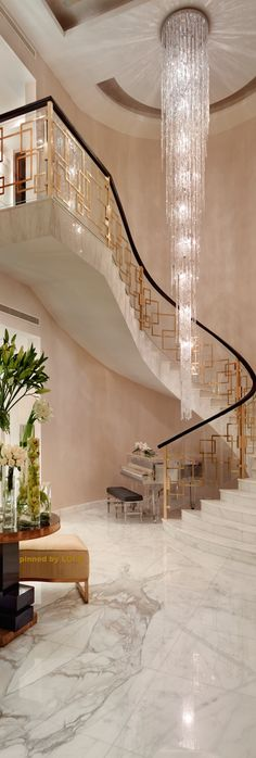Amazing entry/ love the gold railing  the chandelier  ♥