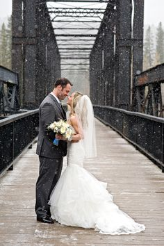 Winter Wedding | Love these two braving the cold! See the wedding on SMP: http://www.StyleMePretty.com/canada-weddings/alberta/2013/12/26/snowy-iron-goat-wedding/ Orange Girl Photographs