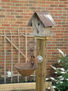 love the simplicity of this birdhouse and the feeder (?)