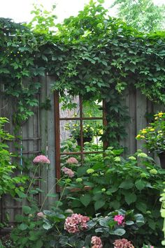 Mirrors!! Great Way to dress up a wall/fence...or any garden!! Love this idea!
