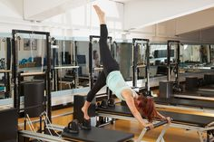 YMCAfit (London LTC) Instructor Trainer Brigitte Wrenn using the footbar for balance