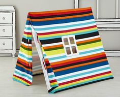 Ideas to transform ordinary spaces to inspire play with children! {Love this Striped Play Tent from @LandofNod}